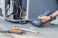 selective-focus-air-conditioning-repair-technician-man-hands-using-screwdriver-fixing-modern-air-conditioning-system_29315-365-300x200.jpg