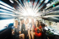 celebration-in-a-limo-woman-and-men-drinking-champagne_orig.jpg