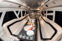 interior-inside-the-limousine-with-sofas-and-a-table-covered-with-snacks-for-the-holiday-selective-focus_3.jpg