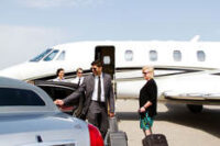 a lady-being-assisted-by-chauffeur-from-exec-jet-to-limo.jpg