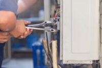 technician-man-using-wrench-fixing-modern-air-conditioning-system-maintenance-repair-concept_29315-386-300x200.jpg